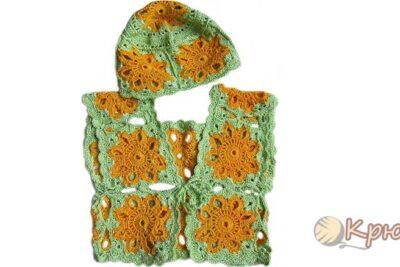 Комплект шапочка и жилетка из мотивов, связанный крючком