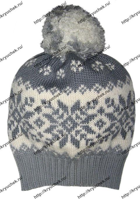 Пример связанной спицами серой шапки с жаккардовым узором «Снежинки»